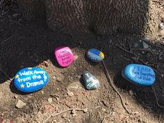 The Kindness Rocks Project by the pond. Hand painted rocks.