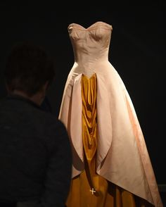 "Shortly after Georgia O'Keeffe's sexually infused art was featured in a retrospective, James created this design, which ""merged his passions for historical styles and erotic sartorial markers,"" according to the museum. ""The shawled overskirt frames the cascade of drapery on the underskirt in an O'Keeffe-like allusion to the primary site of feminine sexuality and procreation."""