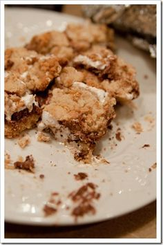 S'MORES COOKIE BARS    1 stick of butter, room temp.    1/4 cup brown sugar    1/2 cup sugar    1 large egg    1 tsp. vanilla extract    1 1/3 cups flour    3/4 cups graham cracker crumbs {about 1 sleeve of crackers crushed}    1 tsp. baking powder    1/4 tsp. salt    2 king size Hershey's bars    1 1/2 cups marshmallow crème/fluff {the entire small jar…7 oz., I think}