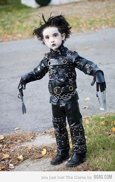 """Adorable Edward Scissorhands cosplay (Halloween), so they say. Poor kid be like, """"I just want to eat the candy."""