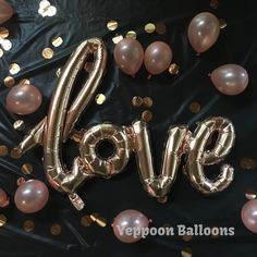 Rose gold foil balloons, latex, confetti and glitter.