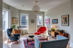 MAD MEN STYLE: I'd love to have that mid-century #modern wingback #chair on the left!