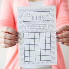 Okay, so this was actually a good, cute, and fun activity for Jenna's shower.  I think it could be for Bridal or Baby Shower, too.  It's a good hybrid of kinda-a-game and not-a-game.  All you have to do is visit our blog to download your copy of these adorable and FREE bridal shower bingo card printables! We love the chevron background!