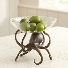 Capturing the captivating quality of the ocean, this eye-catching octopus bowl offers a whimsical display.