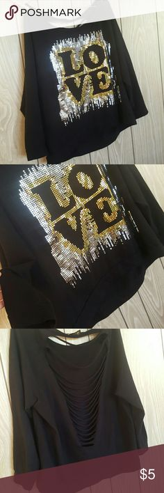 Black Sparkly Love Top It is black and the size is 2X. It fits a 1X or 18 better. It is a sweatshirt material with gold and silver sparkles making the word LOVE. It kinda falls off the shoulder on one side and the back is cut out of it. Making a cool falling pattern. It is super cute and the seller was amazing but unfortunately it didn't lay on me the way I wanted it to so I am reposhing it to a new home. Desiree Tops Sweatshirts & Hoodies