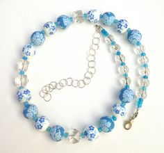 A personal favorite from my Etsy shop https://www.etsy.com/listing/265934192/blue-flowers-necklace