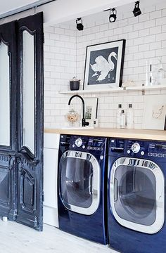 I love this repurposed sliding door system! The only thing I would change up in this laundry is the bench top....