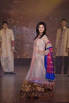 Sushmita Sen modeling an Indian bridal lehnga by Manish Malhotra. Click through for more.