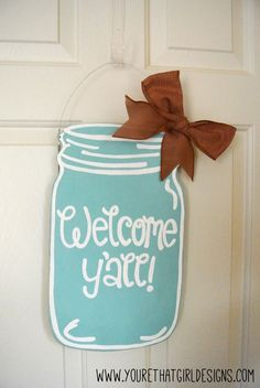 Mason Jar Welcome Y'all Wooden Door Sign  This could be cute for the sign to not choose sides but to sit where they choose.  Of course, it would need to be bigger but the sign would definitely fit the wedding theme.  Could put the mason jar with just welcome y'all on top of a larger board for other wording so that the welcome y'all could be re-used or given as a gift.