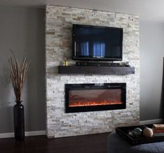Build this affordable DIY electric fireplace in one weekend. Transform your house into a home // via whitneyhansen.com