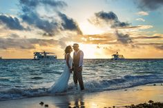 unique beach wedding photos.... would love this minus the boats in the back