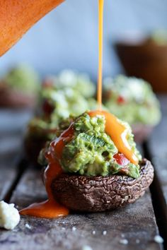 Blue Cheese Guacamole-Stuffed Mushrooms with Buffalo Sauce