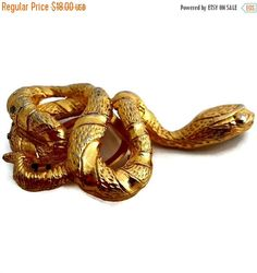 ON SALE Snake Brooch Scarf Clip Gold Plated by EclecticVintager on Etsy https://www.etsy.com/listing/263861567/on-sale-snake-brooch-scarf-clip-gold