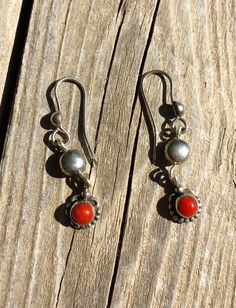 Handmade Flower Shaped Coral and Sterling Silver Beaded dangle earrings by #EnamelArtByLeslie on Etsy. #HandcraftedEarrings #HandcraftedJewelry #HandmadeEarrings #HandmadeJewelry