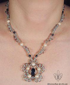 Gray flower necklace N473 by Fleur-de-Irk. Love the flower design