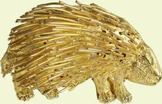Porcupine brooch, 1972. This gold brooch, in the shape of a Kotoko porcupine, was presented to The Queen by Otumfuo Opoku Wareii Asantehene, King of the Ashanti, in 1972.