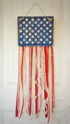 Add some rustic beauty and a touch of patriotic to your home decor with this unique fabric and ribbon rag flag. Each piece is unique....no two flags are alike!! Made with ribbon and fabric lengths of monochrome reds and whites. The star field at the top of the flag is wood, with handpainted stars, and then gently distressed for a worn-in look. Dimensions are 10x36 and flag has a jute cord for easy hanging. If youd like a different size, check out my other options in my shop....there are…