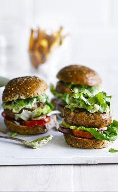 Tasty turkey burgers with a creamy avocado yogurt and sweet potato wedges on the side. Layer the burgers with chilli sauce, sliced tomatoes, red onion and baby gem leaves.