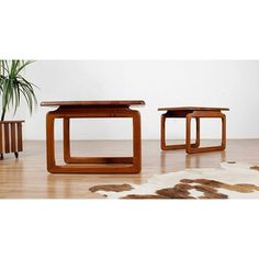 A solid pair of teak mid-century modern end tables by Tarm Stole.