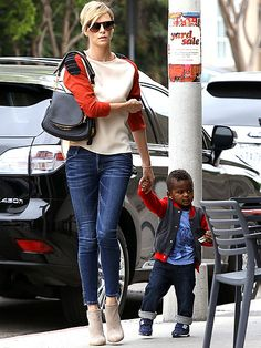 Charlize Theron is one hot momma! The blonde bombshell headed to a lunch date with her main man Jackson, rocking chic flat-top sunnies!