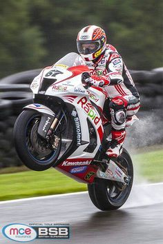 Shakey Byrne, finding enough grip in the wet to wheelie. Check out his eyes looking at the photographer.