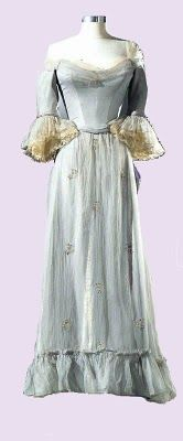 """This second gown was worn by Elizabeth Taylor in 1954 for the film """"Beau Brummell"""" . This period film tells the story of Beau Brummell, played by Stewart Granger who trades a military career for looking good after he insults the Crown Prince. Peter Ustinov plays The Prince of Wales in the film. Taylor portrayed the character of Lady Patricia. Costumes were designed by Elizabeth Haffenden"""