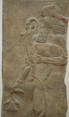 Person holding an ibex and a poppy flower. Low-relief from the m wall of king Sargon II's palace at Dur Sharrukin in Assyria (now Khorsabad in Iraq), c. 713–716 BC. From Paul-Émile Botta's excavations in 1843–1844.