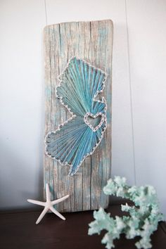 I would do the string art in the shape of wherever the wood is from...Cape Cod or all of Massachusetts
