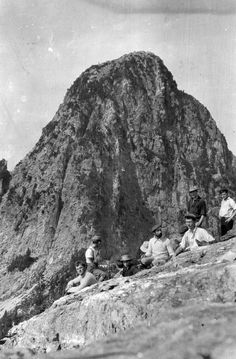 A group of hikers take a break on The Lions. Photo taken circa 1920 by Franklin Walter Hewton, courtesy the Vancouver Archives.