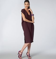 VOGUE 1496- V-NECK COCOON DRESS. #Sew your own: https://voguepatterns.mccall.com/v1496 #Sale #pattern Very loose-fitting, tapered, pullover dress has V-neckline, optional pockets (stitched in place), front extending into yoke back, no shoulder seams, back armhole openings with narrow hem, and stitched hem. Suitable Fabrics: Drapey Wovens or Drapey Knits.