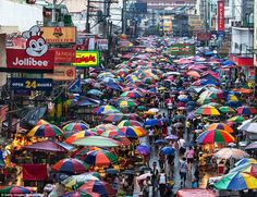 Retail therapy: Manila offers plenty of street vendors, but also boasts 16 air-conditioned 'super malls' that are decidedly middle-class Philippines Travel Guide, Manila Philippines, Quirky Art, Music Backgrounds, Paradise Island, Slums, World Of Color, Urban Photography, Archipelago