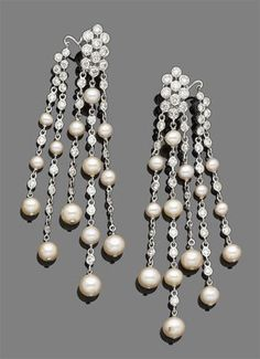 Lot 54 - A pair of cultured pearls fringe earrings with 2.30cts of diamonds