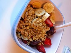 I am obsessed with acai bowls.... Acai blended with a little juice- topped with fresh strawberries, bananas, granola and a touch of honey. Healthy and delish!!