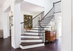 Southern Home with Neutral Interiors--this striking foyer lets the stairs be the star. Simple decor keeps the foyer uncluttered and welcoming. Transitional Living Rooms, Transitional House, Transitional Lighting, Staircase Design, Foyer Staircase, Staircase Ideas, Staircase Architecture, Railing Design, Modern Architecture