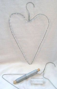 just wrap it in tinsel or lights or ivy, makes a very cute decoration. now i can put all those annoying metal hangers to good use! Valentines Day Decorations, Valentine Crafts, Christmas Crafts, Valentine Wreath, Wire Hanger Crafts, Wire Hangers, Chicken Wire Crafts, Metal Coat Hangers, Deco Boheme
