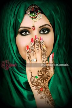 True beauty is in the eyes' of the beholder..i love the nails and the henna