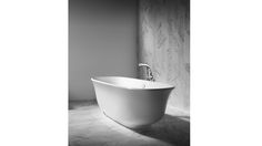 "Amiata tub from Victoria & Albert.  Lovely curves.  24""H x 31.5""W x 64 3/4""L.  Holds 85 gallons."