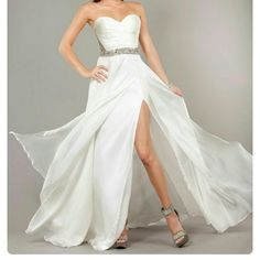Jovani pageant prom wedding dress NWOT; Off white flowy silk skirt with thigh slit.  Beautiful rhinestones over nude mesh on back, back zip. Tag size 8, runs slightly large. Jovani Dresses Strapless