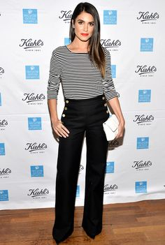Nikki Reed in a striped MaxMara skirt and high-waisted pants