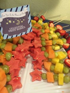 """Celestial fruit bodies"" love you to the moon and back baby shower theme. Star shaped fruit skewers."