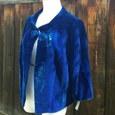 "Cobalt Blue Velvet Vintage Jacket NOS-60s Rich cobalt blue velvet jacket from the 60s. Frog closure, Mandarin collar, frog closure, satin lining, 3/4 sleeves. New old stock. Chest 19"" Shoulders 15"" Length 21"" Arms 17"". Price tag is marked $39.95 from the 60s. Equivalent pricing today is roughly $300 so this was a higher end piece. Vintage Jackets & Coats"