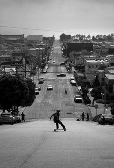 Skater riding down a steep hill