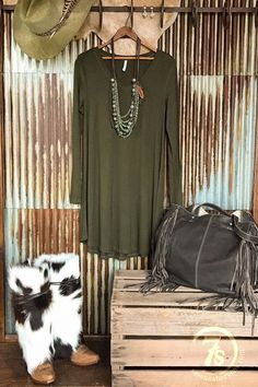 - Olive long sleeve t-shirt dress - Deep v-neck - Soft and stretchy - Rounded hem - Slim fit thru sleeves and shoulders - Relaxed and flowy below the chest - Good longer length hitting above the knees
