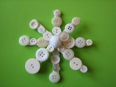 Button and popsicle stick snowflake