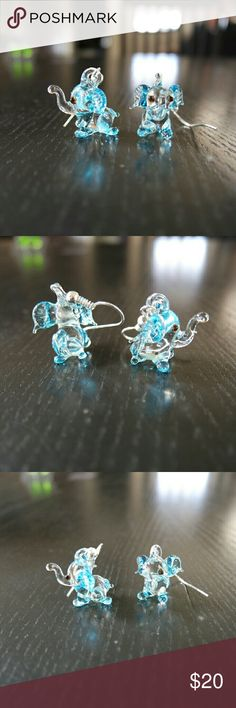 Elephant shaped glass earrings from Mexico These one of a kind earrings are each hand made by Mexican artisans in the state of Jalisco.  #mexican  #artisan  #handmade  #glass   ***Note: there may be slight differences on each earing due to it being handmade*** Jewelry Earrings