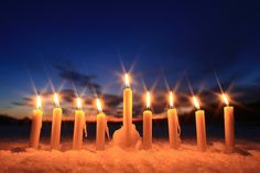 hanukkah candles in the snow