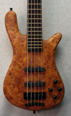 I want this bass more than any other base ever! Its a Warwick, the top is made from the wood in the roots of USA Redwoods.