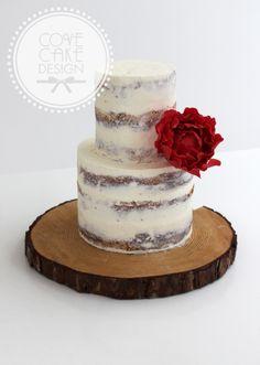 Semi-naked cake with raspberry sugar peony