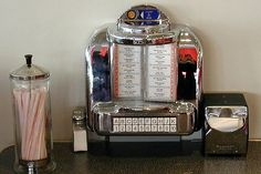 Individual juke box at your table.  Usually it was a booth.  Yikes, someones hands touched those straws!!!!