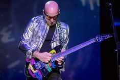 """Guitarist Joe Satriani performs on stage during """"The Shockwave Tour"""" at Balboa Theatre on March 2016 in San Diego, California. Joe Satriani, San Diego, Theatre, Stage, March, Tours, California, Guitars, Theatres"""